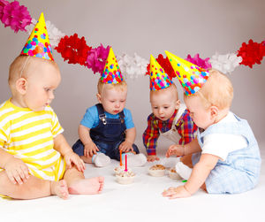 toddlers at a birthday party