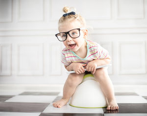 little girl with glasses potty training
