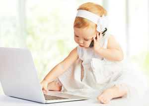 baby girl on phone and computer