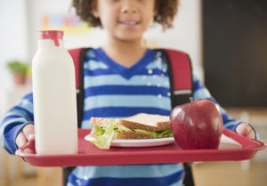 African American girl holding lunch tray