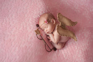 newborn girl as cupid