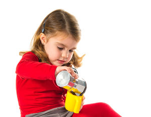 little girl in red shirt playing