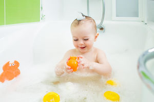 baby playing in tub