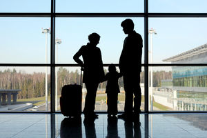 silhouette of family at airport