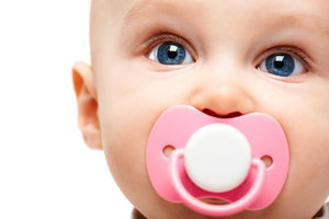Child with Pink Pacifier