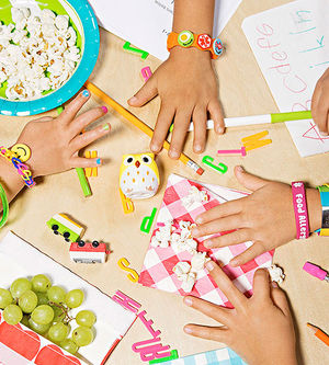 kids' hands with allergy bracelets on
