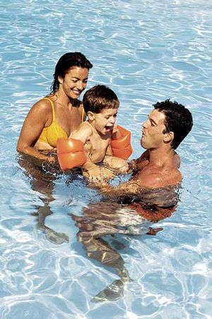 Mom and Dad with Son in Pool