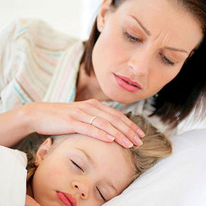 mother checking daughter's fever
