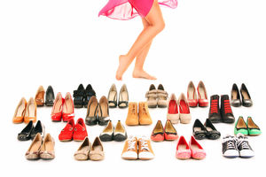 woman with a lot of shoes