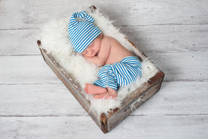 infant boy sleeping in sleeping cap