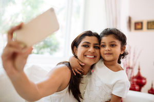 Woman taking selfie with daughter