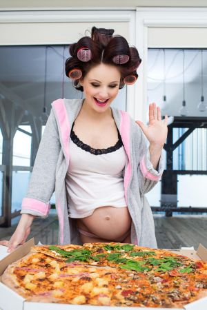 Pregnant Woman Eating a Pizza