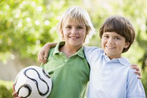 Friends Holding a Soccer Ball