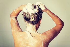 Woman shampooing her hair