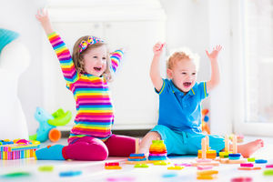 Boy and girl excited about playing with toys