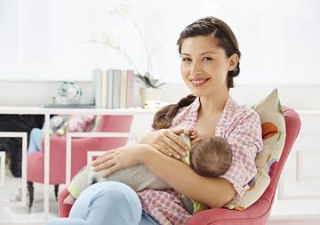 Mom with Braided Hair Breastfeeding Newborn