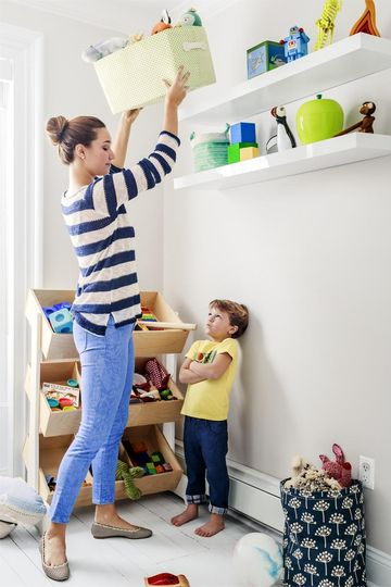 Mom Lifting Box Above Son