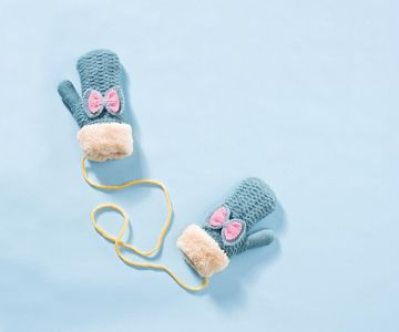 Snow Mittens with Blue Background