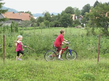 brother and sister riding bikes in croatia