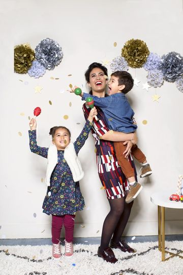 Mom and Kids Throwing Confetti at Holiday Party