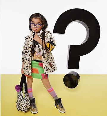 Girl with Pigtails and Glasses Thinking