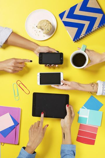 Gadgets on Yellow Table