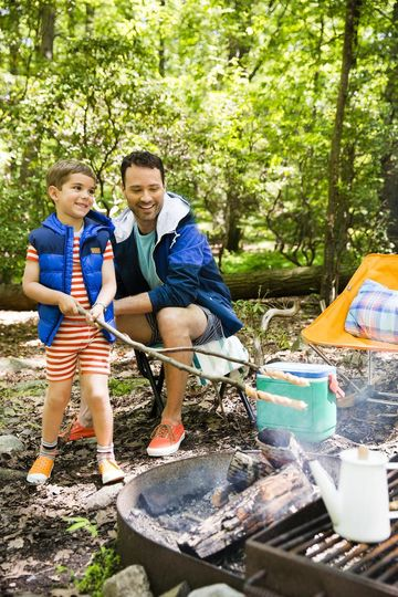 Dad and Son Making Campfire