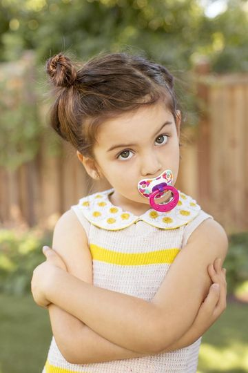 Toddler with Pacifier in Her Mouth