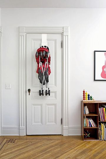 MetroTots Stroll Away Hooks On Door Holding Red Stroller
