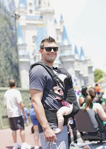 Disney Theme Park Getting Around Father Wearing Sunglasses Carrying Baby