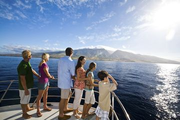 Family on Boat in Maui Hawaii Looking at Mountains