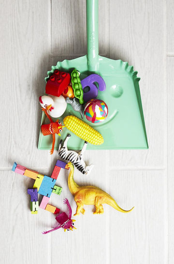 Spring Organizing Toys On Floor in Green Dustpan