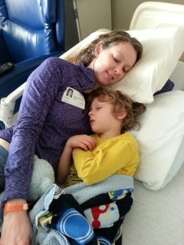 Stephanie Morrill and Connor Laying In Hospital
