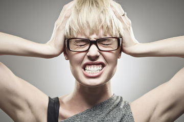 Woman with Headache Wearing Glasses