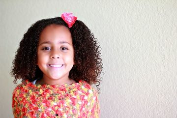 Young girl with curly hair