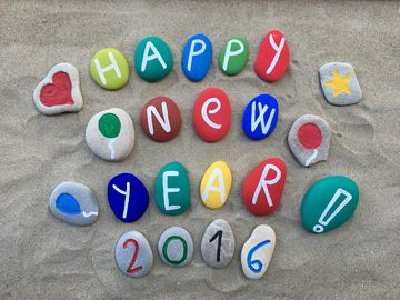 Happy New Year 2016 stones on sand