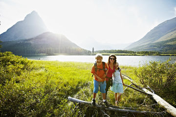 Family in Glacier National Park at sunset laughing