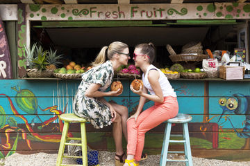 Mom and Daughter at Fruit Stand on Vacation