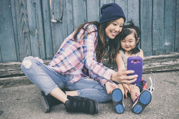 Korean mother and daughter taking pictures together