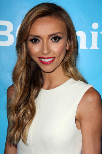 Guiliana Rancic blue background