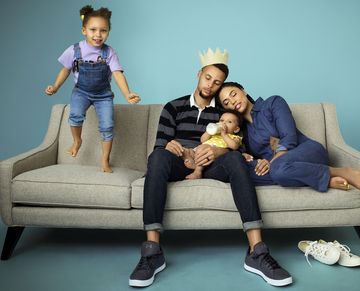 Stephen Curry and Ayesha Curry on couch with daughters