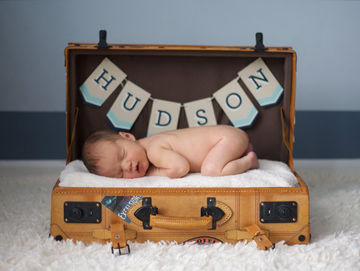 baby with name banner