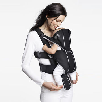 Mom and baby using Baby Bjorn Miracle Carrier