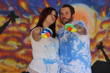Squirt gun filled with paint idea for gender reveal for expecting couple