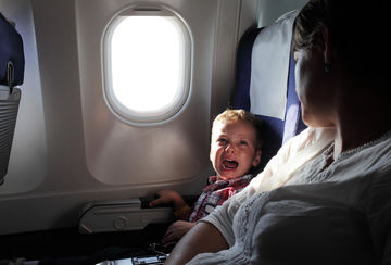 boy crying on airplane