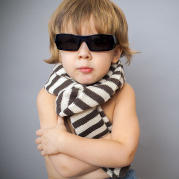 boy-in-sunglasses-and-striped-scarf-arms-crossed_600x600_shutterstock_175883807