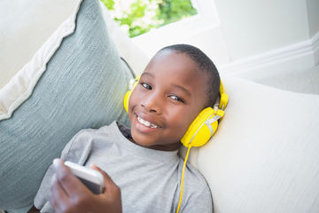 boy listening to podcast