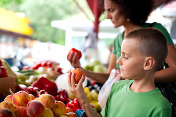 Boy and mother shopping at farmer's market