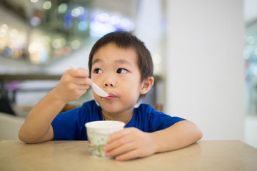 Boy Eating Frozen Yogurt