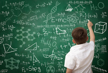 young boy doing complicated math problems